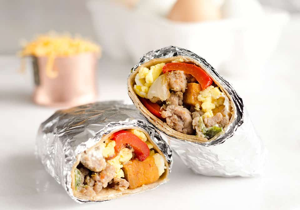 Light & Spicy Turkey Sausage Breakfast Burritos are a healthy freezer-friendly breakfast full of lean Jennie-O turkey sausage, scrambled eggs and roasted vegetables. Grab one from the freezer for a quick protein packed meal on the go or sit down with it to enjoy a hearty breakfast.