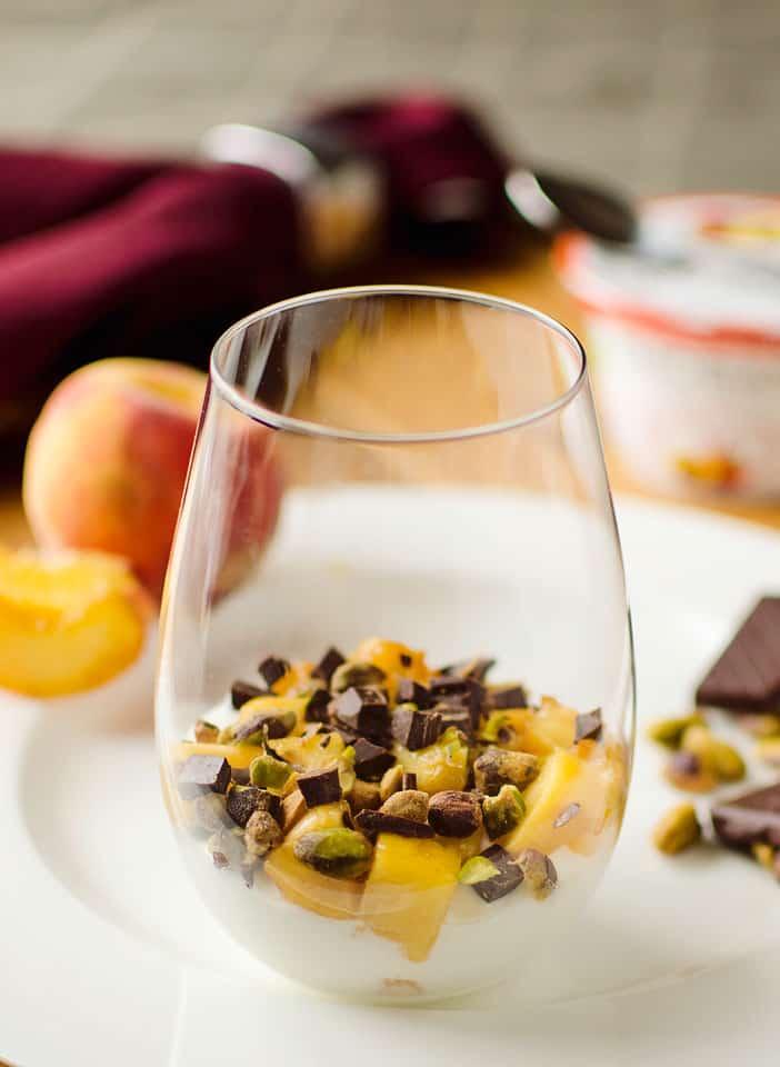 Peach Yogurt Parfait with pistachios and dark chocolate - The Creative Bite