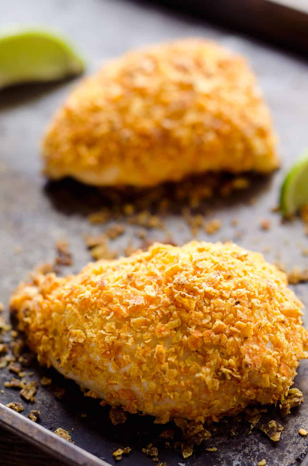 {3 Ingredient} Cheesy Dorito Chicken is a light and delicious dinner with tender chicken breasts stuffed with a creamy queso fresco cheese and coated in crunchy Dorito chips.