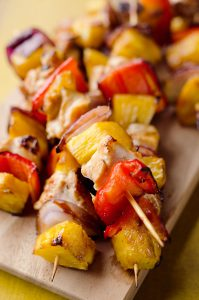 Teriyaki Chicken Kabobs are a healthy low-carb dinner bursting with flavor. These easy kabobs are prepared on the grill or in the oven and are loaded with lean chicken, bell peppers, onions and juicy pineapple for a balanced meal.