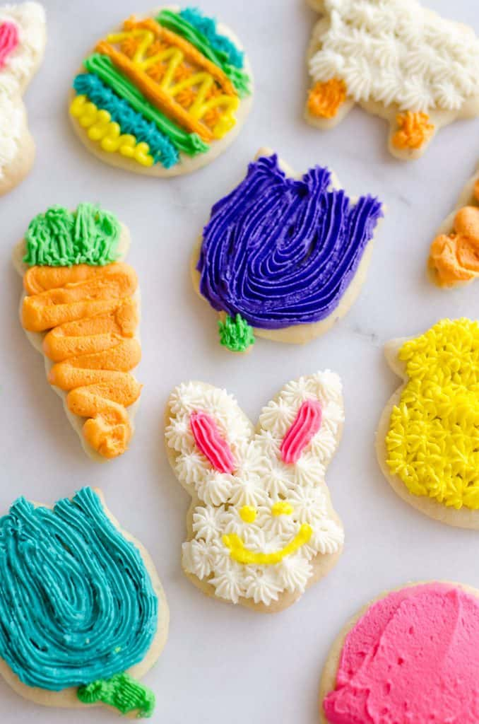 These Frosted Sugar Cookies are the best you will ever try! These adorable spring cut-outs have a cake-like softness topped with a rich buttercream frosting and the perfect balance of sweetness.