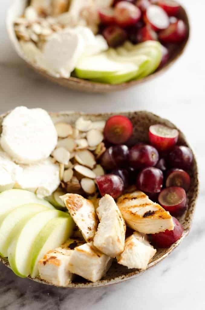 Fruit & Goat Cheese Chicken Bowls are a fresh and easy recipe for a healthy dinner loaded with sweet and savory flavors. Tender chicken breasts are paired with juicy grapes, apples, almonds and creamy honey goat cheese for an amazingly simple meal!
