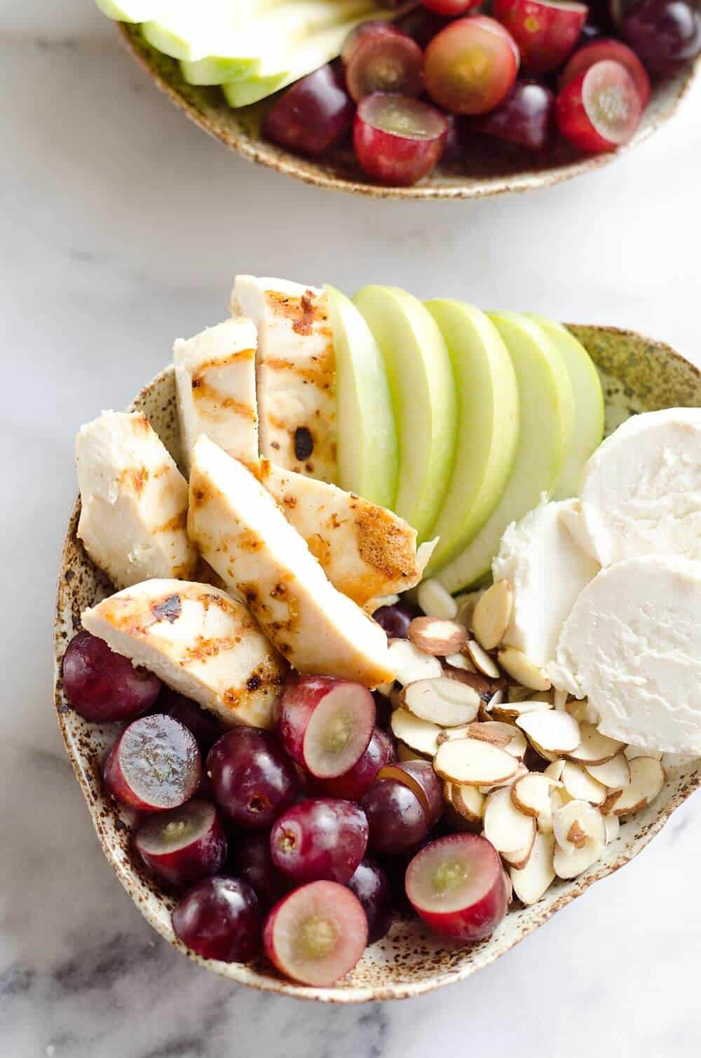 Fruit & Goat Cheese Chicken Bowls are an easy 5 ingredient recipe for a healthy dinner loaded with sweet and savory flavors. Tender chicken breasts are paired with juicy grapes, apples, almonds and creamy honey goat cheese for an amazingly simple and protein packed meal ready in only 15 minutes!