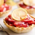 Mini Strawberry Lemon Pies are the perfect dessert recipe to serve your party guests for an individual sweet they will love! A flaky pie crust is topped with a lemon cream cheese layer, fresh strawberries and a sweet strawberry lemon sauce for tons of great flavor and texture!