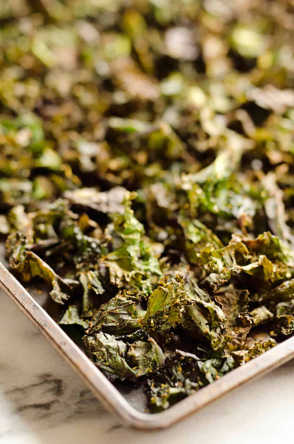 Spicy Kale Chips are beautifully crisp and loaded with bold chipotle flavor for a healthy 5 ingredient snack. They are perfect for the munchies or paired with your favorite sandwich on the side!