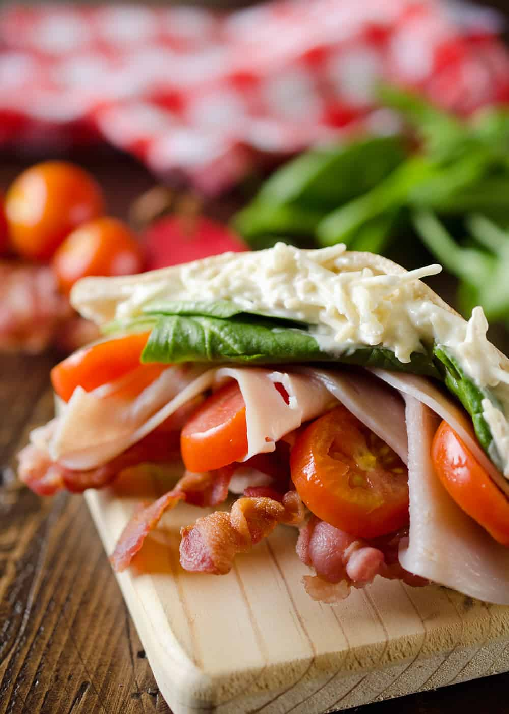 Parmesan Ranch Turkey BLT Pita is an easy and flavorful lunch loaded with bacon, lettuce, tomato, turkey and a delicious parmesan ranch. This sandwich recipe is perfect for a quick summer lunch everyone will love!