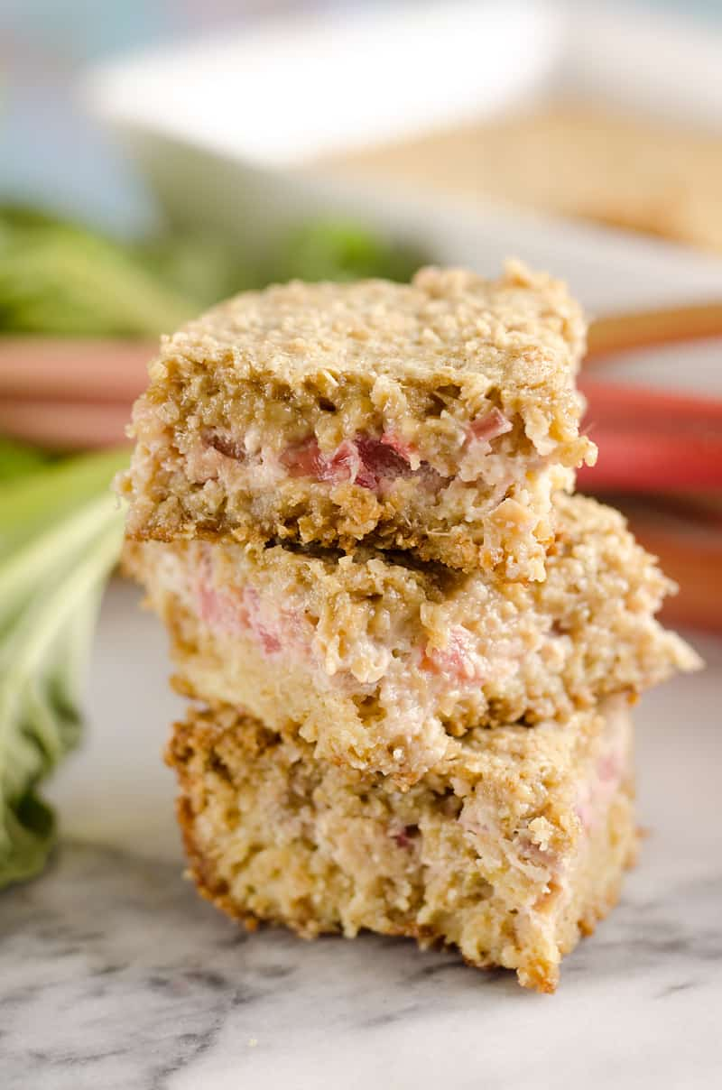 Rhubarb Custard Oatmeal Bars are a fun twist on a favorite summer treat. Fresh rhubarb and custard are layered with chewy oatmeal layers for a dessert that everyone will love!