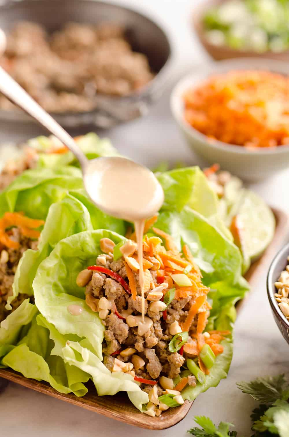 Turkey Thai Peanut Lettuce Wraps are a light and healthy dinner idea packed with filling ground turkey, fresh vegetables and crunch peanuts. This is a dinner idea you can enjoy over and over, it is simply that good!