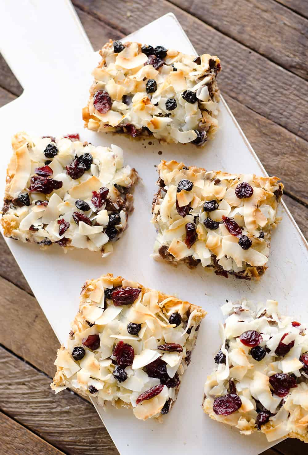 Berry Coconut Magic Bars are amazingly easy to whip together and have the great flavors of chocolate and dried berries for a fun twist on a classic dessert.