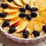 Light Peach & Berry Tart is a lightened up dessert loaded with an orange, cream cheese and Greek yogurt layer and topped with fresh peaches and berries for a spectacular sweet!