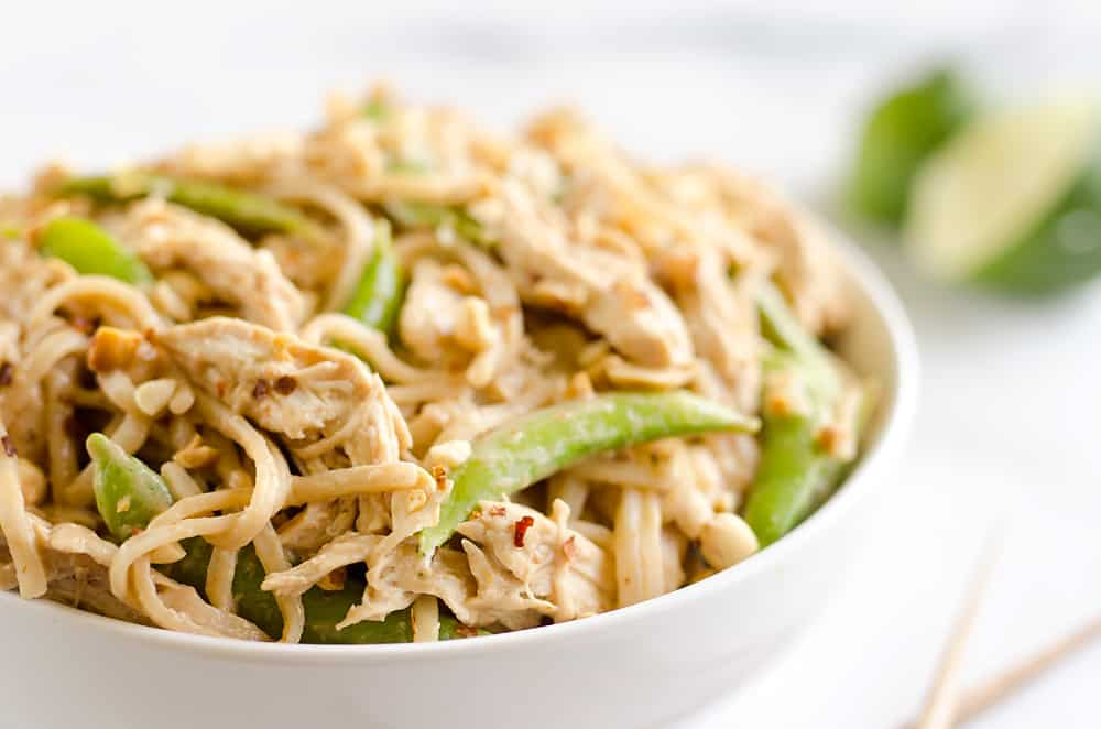 Pressure Cooker Thai Peanut Chicken & Noodles is the best 30 minute Pressure Cooker recipe you will find! Lean chicken breasts are cooked in a homemade spicy Thai peanut sauce and finished off with rice noodles and peas for an easy and healthy one-pot meal made in your Instant Pot.