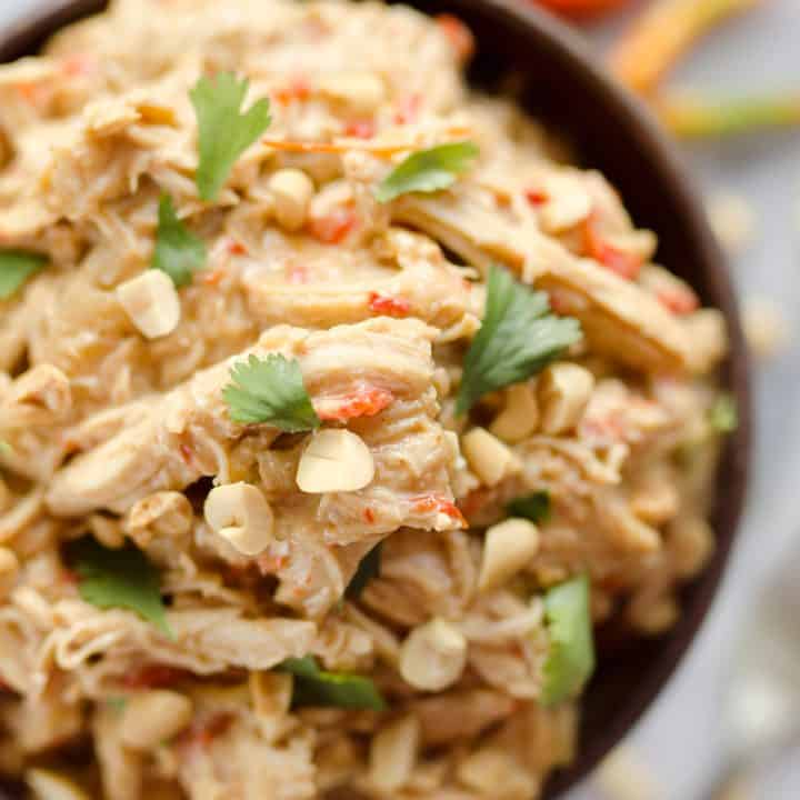 Crock Pot Thai Peanut Chicken is an easy weeknight dinner idea you can make with everything from rice and veggies to lettuce cups for a healthy and delicious meal!
