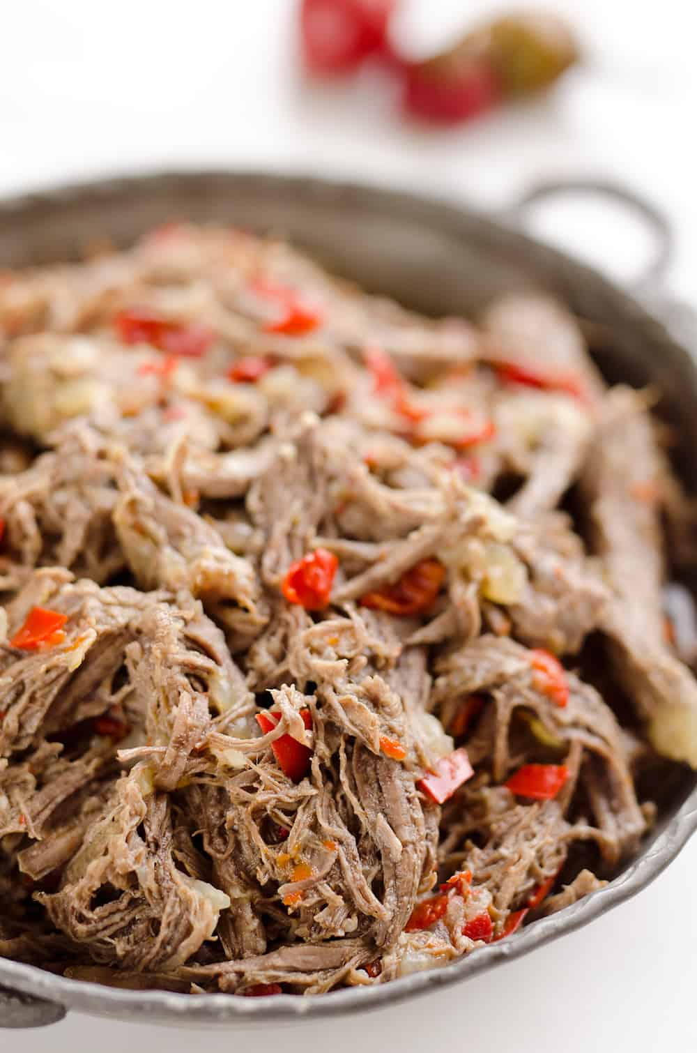 Pressure Cooker Shredded Italian Beef is an easy no fuss recipe made with simple ingredients! Serve this beef along with your favorite veggies for a healthy low-carb dinner idea or pile it high on fresh buns for a delicious sandwich!