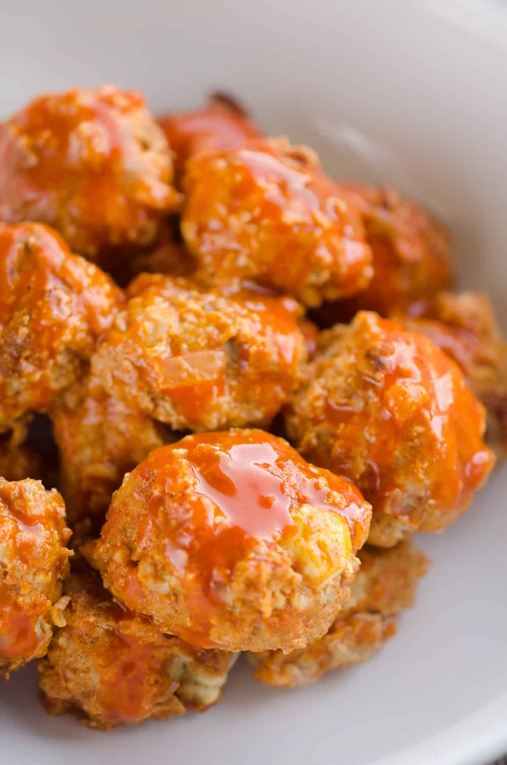 Light Crock Pot Buffalo Turkey Meatballs are an easy recipe made in your slow cooker bursting with bold flavor from spicy buffalo sauce and bleu cheese crumbles! Serve them as an appetizer on game day or pair them with a side of rice and veggies for a flavorful dinner.