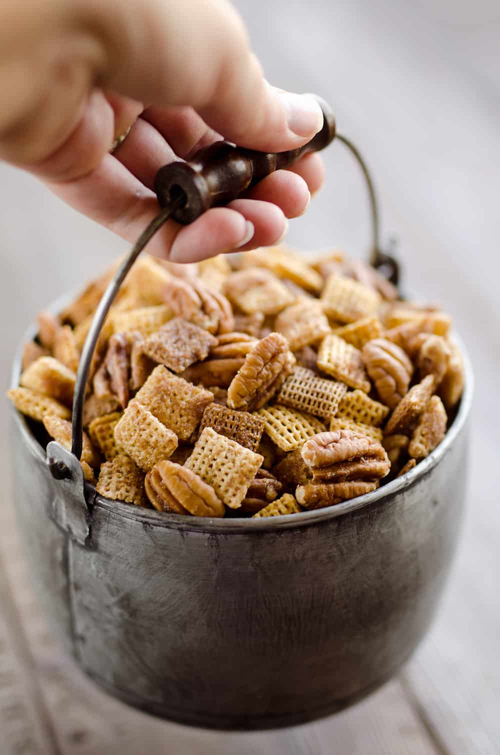 Sweet & Spicy Pecan Snack Mix is a delicious treat with Chex coated in a spicy cinnamon brown sugar mixture and tossed with pecans. This delicious Chex Mix will disappear quickly at your next holiday gathering!