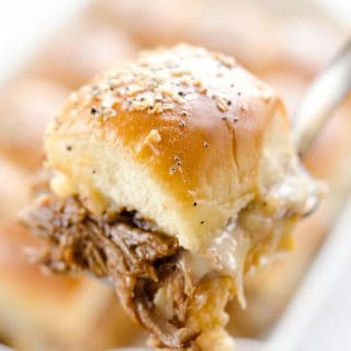 Cheesy BBQ Pork Baked Sliders are and easy family friendly meal you will want to make again and again! Pressure Cooker BBQ Pulled Pork and creamy Havarti cheese is layered on Hawaiian buns and topped with a savory butter sauce for a dinner that is absolutely drool worthy.