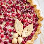Cranberry Orange Custard Pie is a festive and unique pie to enjoy during the holiday season. Silky sweet custard laced with orange zest and tart cranberries fill a flaky pie crust for a delicious dessert you will love!