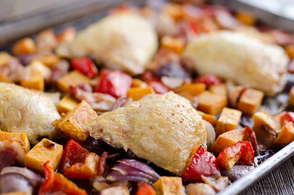 Harvest Chicken Sheet Pan Dinner is an easy and healthy dinner with chicken thighs and roasted vegetables that will come together in no time!