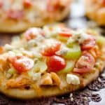 Mini Buffalo Turkey Pizzas are an easy and flavorful way to use up leftover turkey for a quick and delicious dinner idea or crowd pleasing finger food for game day!
