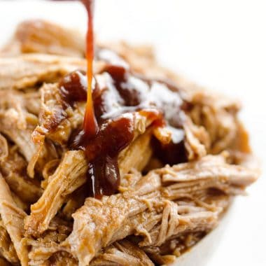 Pressure Cooker BBQ Pulled Pork is an easy three ingredient recipe that makes for tender and delicious pork that is perfect for sandwiches or wonderful paired with rice and vegetables for a healthy dinner idea.