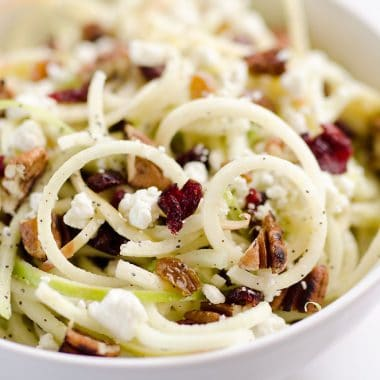 Spiralized Apple Cranberry Salad is an easy and healthy recipe made with crunchy apples, cranberries, pecans and goat cheese all tossed in a light Citrus Poppy Seed Dressing. This salad makes for a a deliciously easy side dish or vegetarian entree you will love!