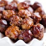 Crock Pot Cheddar BBQ Meatballs make for a flavor packed dinner paired with potatoes or a fantastic appetizer for the big game or holiday bash! Tender beef meatballs loaded with onion and cheese are simmered in your favorite BBQ sauce for a wonderful recipe made in your slow cooker.