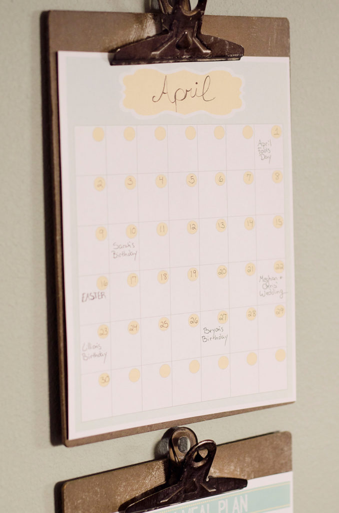 Free Printable Meal Planner calendar hanging on clip board