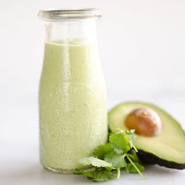 Avocado Lime Green Goddess Sauce is a light and healthy dressing made with creamy Greek yogurt, avocado, garlic and herbs. It is perfect on a salad or as a dipping sauce for chicken and steak!