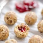 PB&J Surprise Energy Bites are a fun and healthy no bake snack with a peanut butter and oat mixture and a surprise pop of strawberry jelly on the inside.