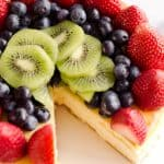Creamy New York Cheesecake with Fresh Fruit is a rich and decadent dessert recipe that is sure to impress all your dinner guests!