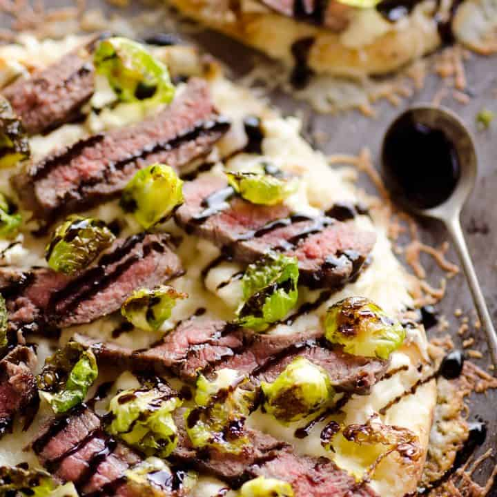 Steak, Goat Cheese & Roasted Brussels Sprouts Flatbread with spoonful of balsamic glaze