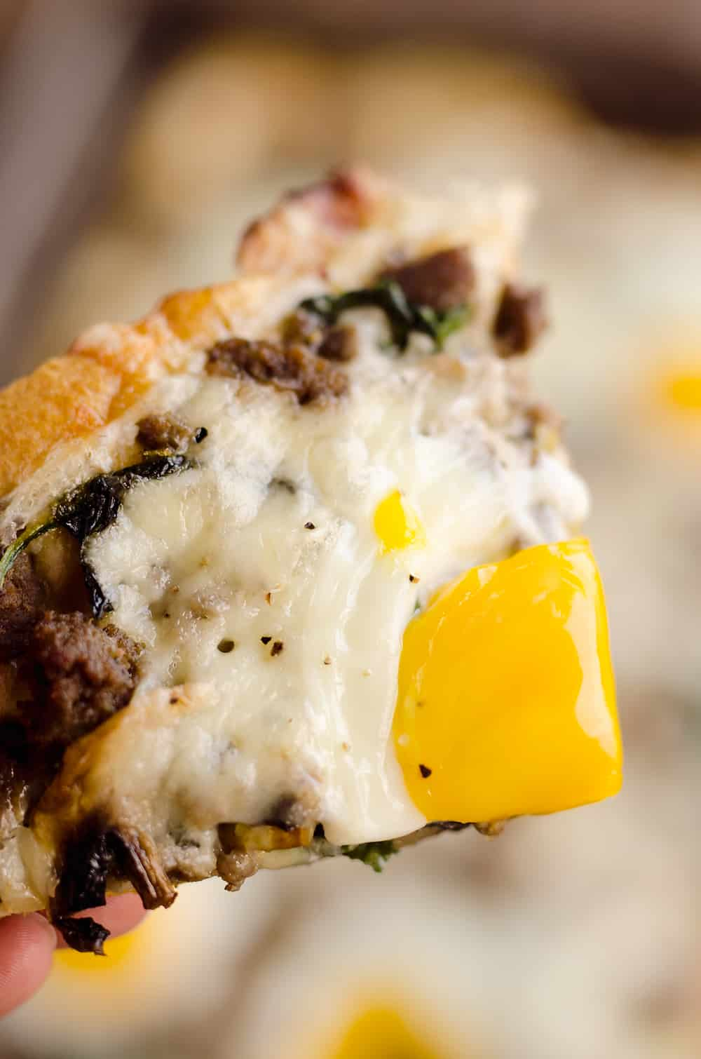 Turkey Sausage Breakfast Pizza is an easy recipe containing all of the best parts of breakfast! A flaky crescent crust is topped with a mixture of lean Jennie-O turkey sausage, vegetables, creamy Havarti cheese and soft baked eggs for a meal you won't soon forget.