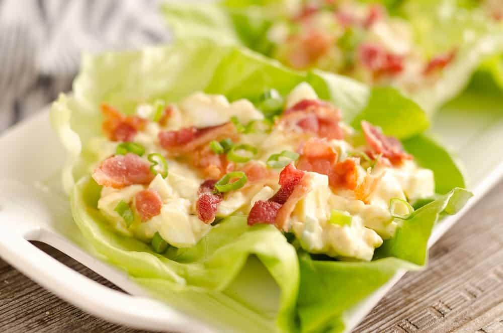 Light Bacon Egg Salad Lettuce Cups are an easy and healthy low-carb lunch idea made with Greek yogurt and topped with crispy bacon for amazing flavor!
