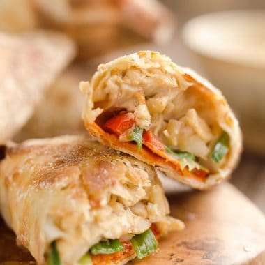 Airfryer Baked Thai Peanut Chicken Egg Rolls are a light and healthy recipe made in your Airfryer or oven. Chicken is tossed with creamy Thai peanut sauce, carrots, red peppers and green onions and rolled in crispy egg roll wrappers for a flavorful dinner you can make in just 20 minutes.