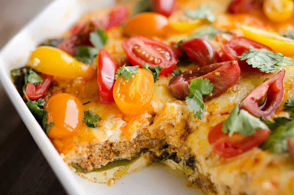Roasted Poblano & Chorizo Egg Casserole is a low-carb breakfast recipe perfect for brunch or dinner! Fire roasted peppers are layered with spicy Chorizo and Mexican cheeses for a healthy egg bake bursting with bold flavors.