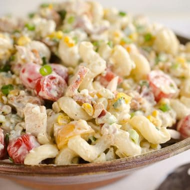 Creamy Turkey Cobb Pasta Salad is a fresh and flavorful side dish perfect for your next picnic or potluck. Pasta, Jennie-O turkey breast, bacon, bleu cheese and veggies are tossed in a zesty avocado sauce for a salad bursting with flavor and crunch.