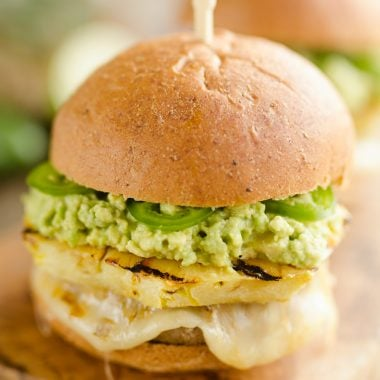 Grilled Pineapple & Guacamole Turkey Burger is a healthy and easy recipe made on the grill! Juicy Jennie-O Turkey Burgers are topped with pepperjack cheese, sweet grilled pineapple, guacamole and fresh jalapeños for a zesty burger perfect for any grill out.