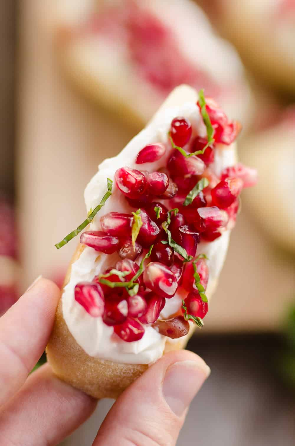 Pomegranate Goat Cheese Crostini being served