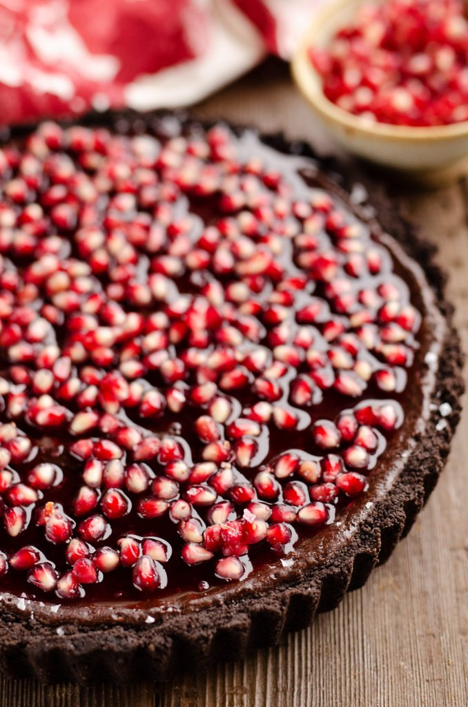 dark chocolate tart topped with pomegranates