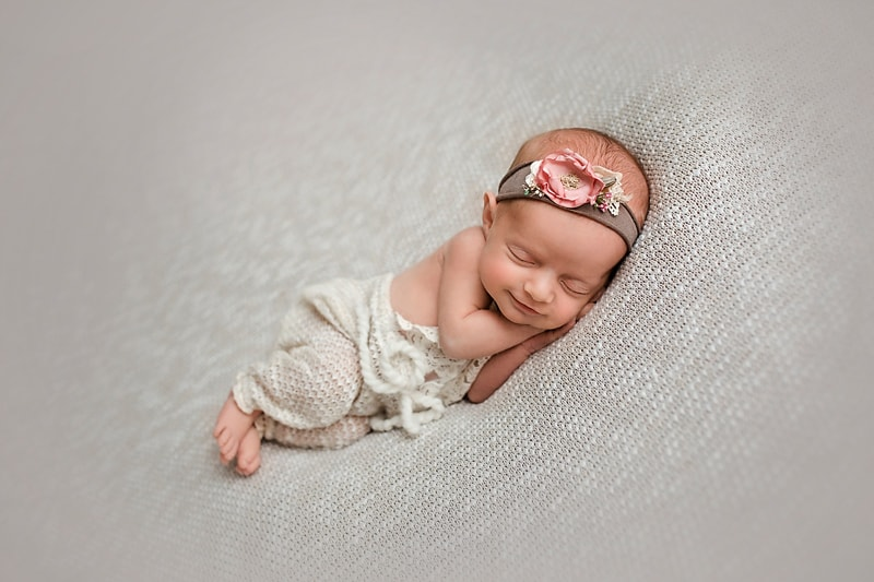 newborn baby smiling girl photograph