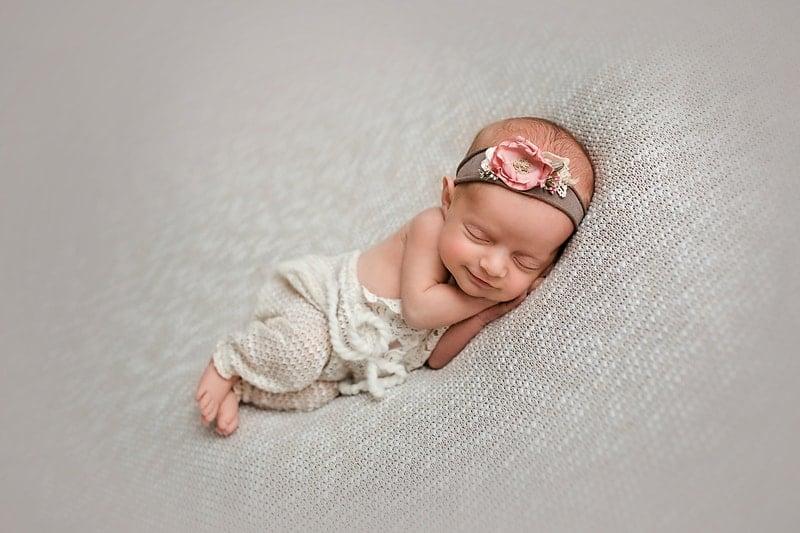 newborn baby smiling girl photograph