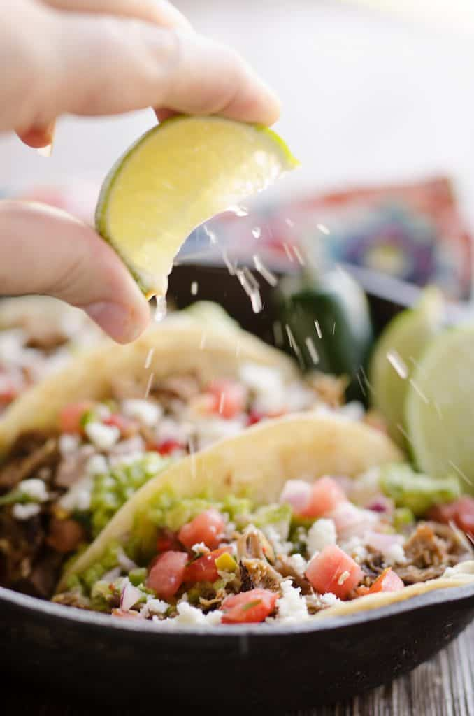 Pork Carnitas Street Tacos with squeeze of lime wedge
