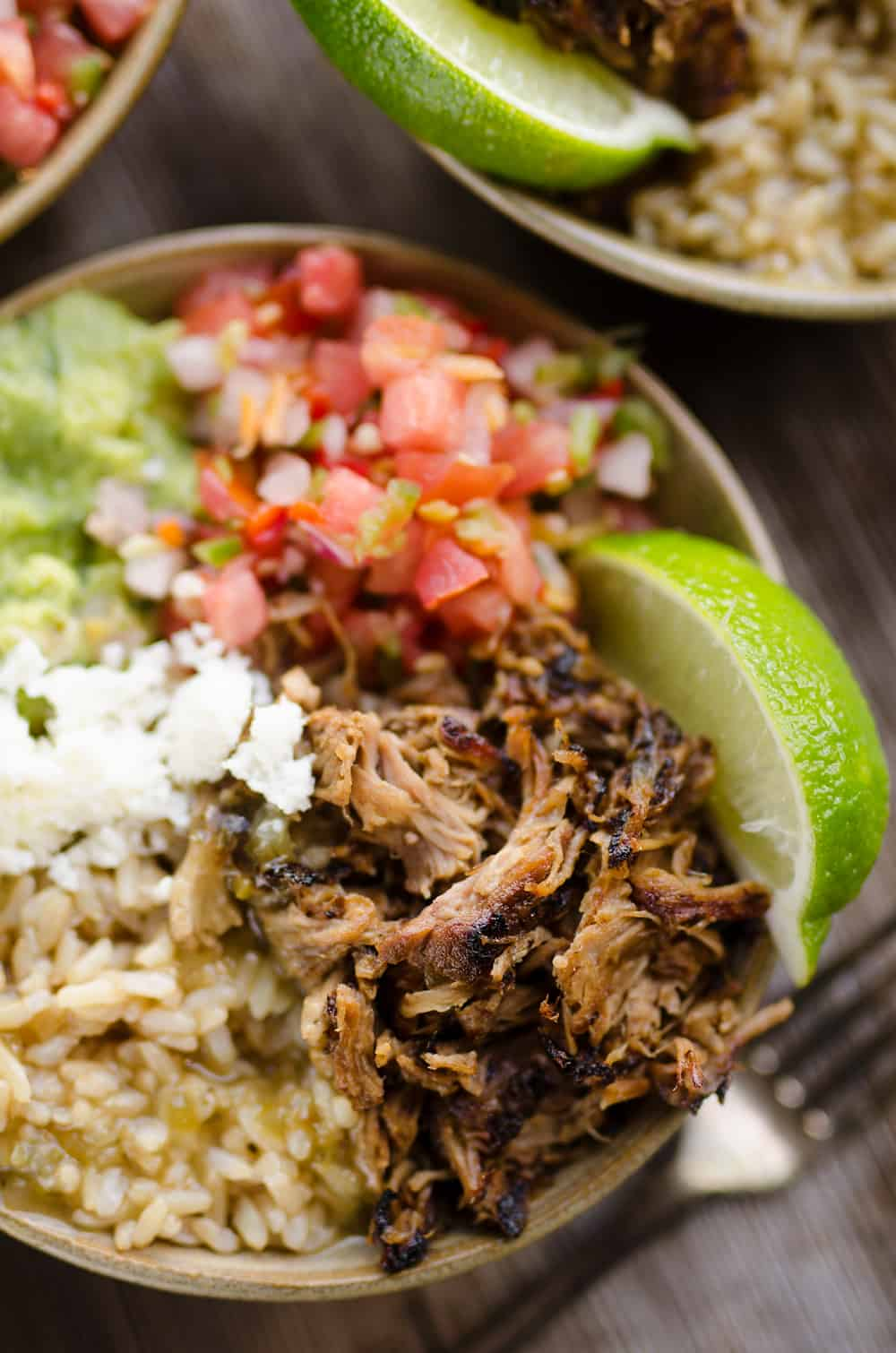 Easy Pork Carnitas Rice Bowls in serving bowl