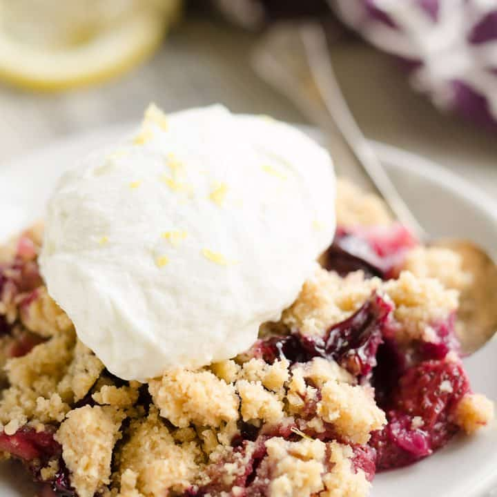Lemon Berry Crisp topped with lemon whipped cream