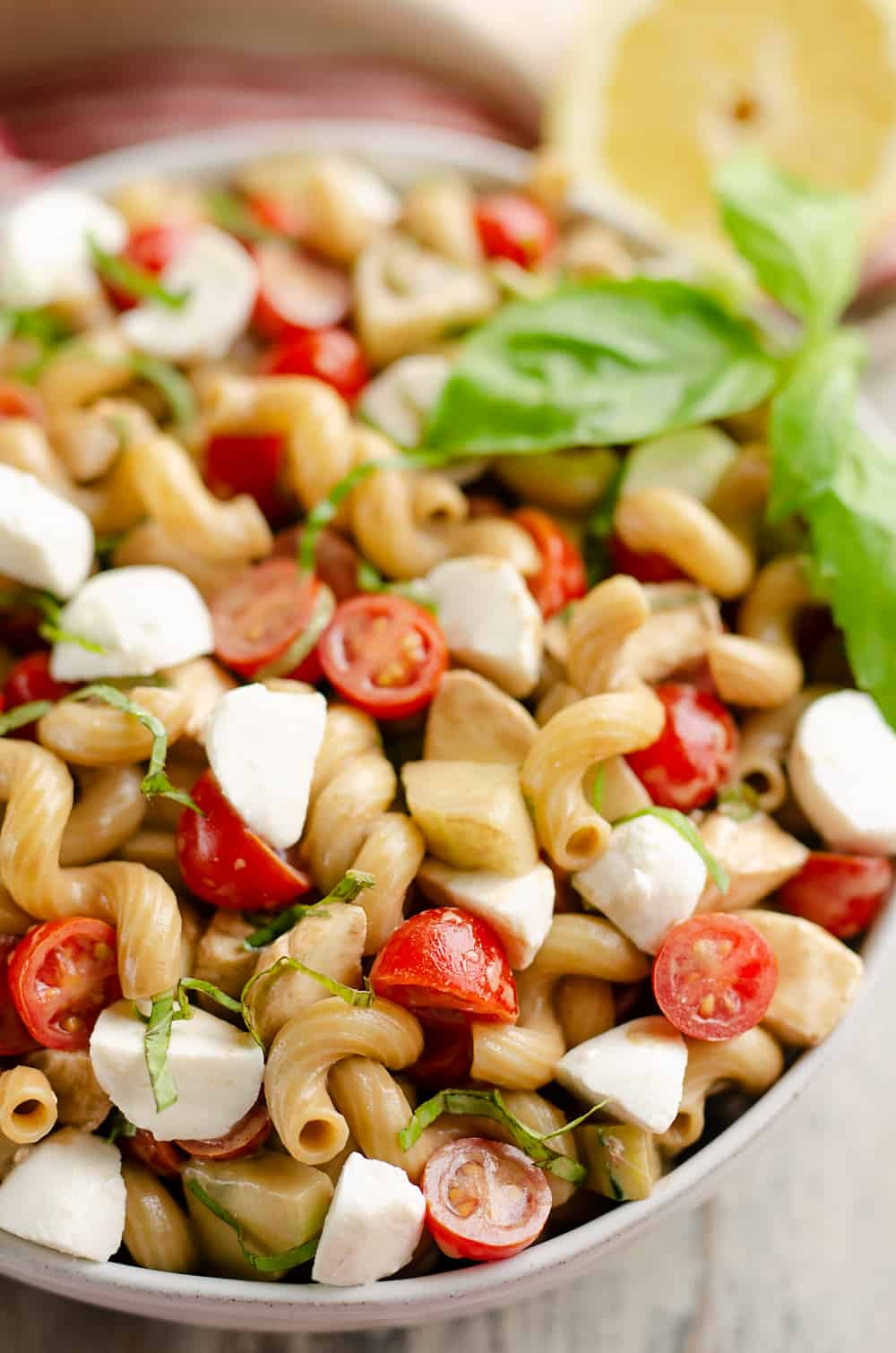 Balsamic Caprese Pasta Salad in serving bowl