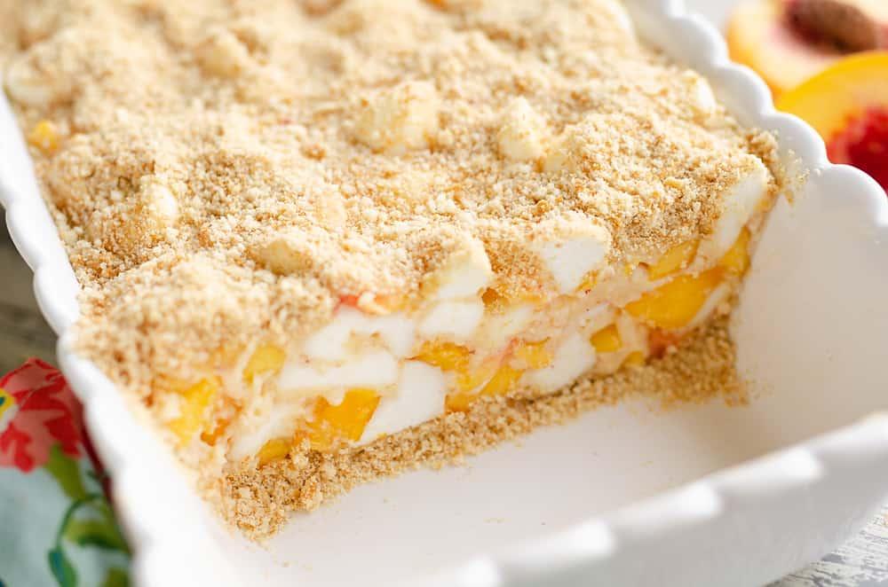 Marshmallow Peach Icebox Dessert cut up in pan