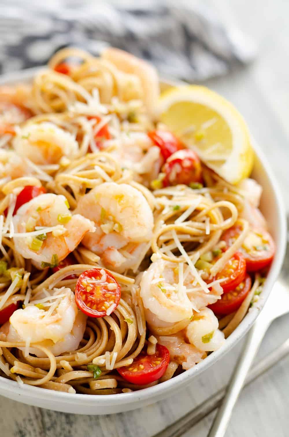 Parmesan Lemon Shrimp Linguine in serving bowl with utensils