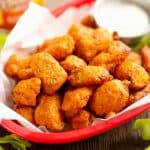 Airfryer Buffalo Cauliflower Tots served with celery and ranch