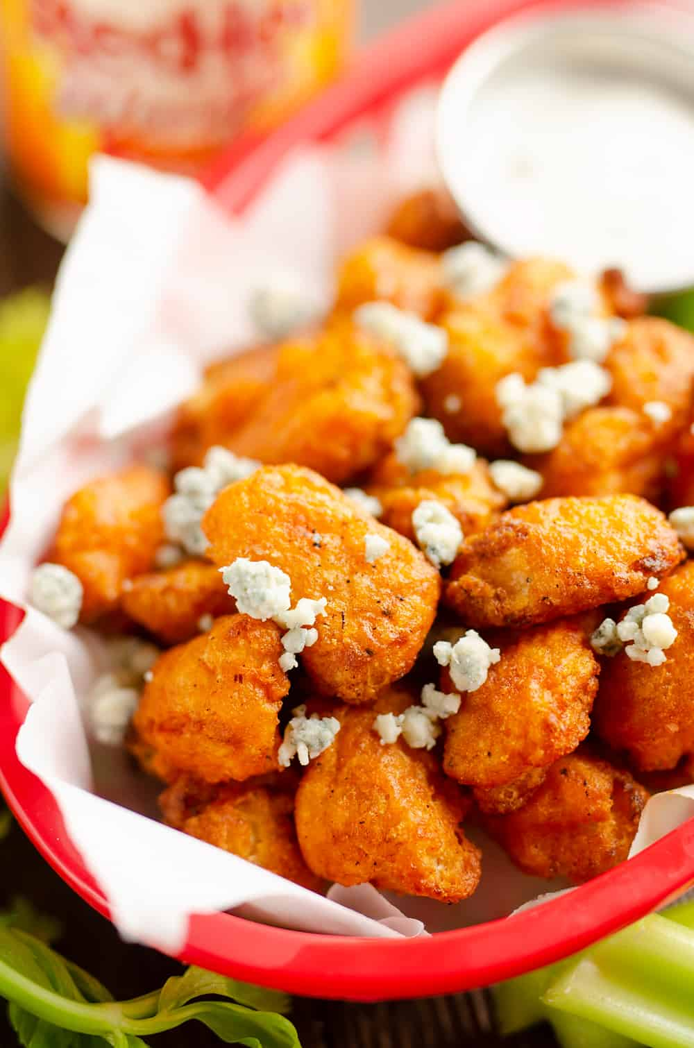 Airfryer Buffalo Cauliflower Tots in basket with bleu cheese