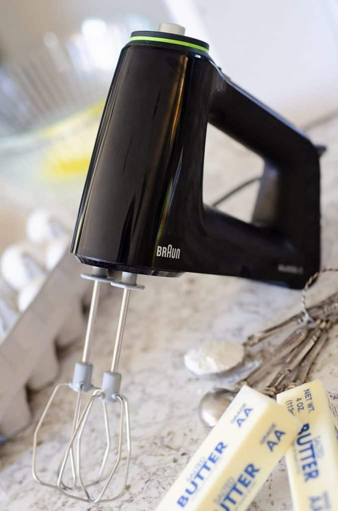Braun MultiMix Hand Mixer in kitchen with baking ingredients